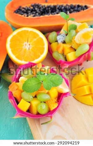 Fresh fruit salad served in half a dragon fruit - stock photo
