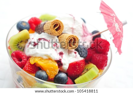 Fresh fruit salad with cookies and ice cream - stock photo