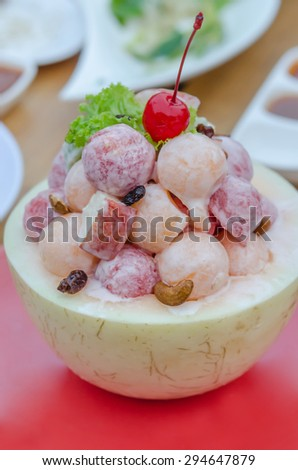 Fresh Fruit Salad with cream sauce in Cantaloupe Bowl - stock photo