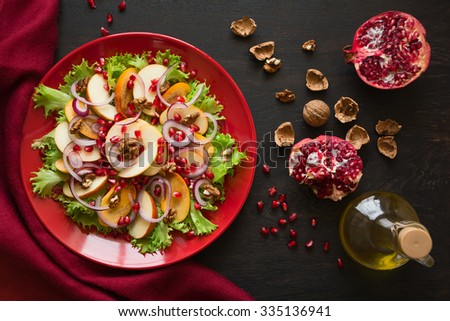 Fresh fruit salad with persimmons and garnet - stock photo