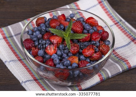 Fresh fruit salad with strawberries and blueberries , wild berry. Close up - stock photo