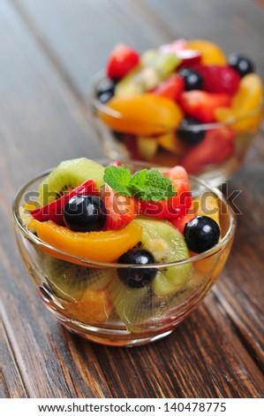 Fresh fruit salad with strawberry, kiwi and blueberry - stock photo