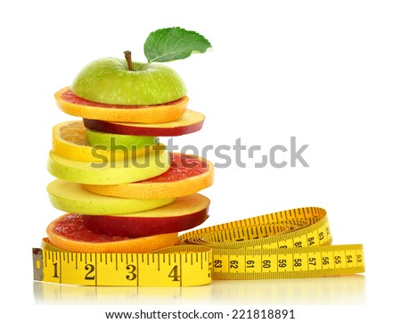 Fresh fruit slices and measuring tape isolated on white - stock photo