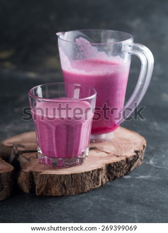 Fresh fruit smoothie served in glass and jug, selective focus - stock photo