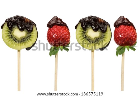 fresh fruit sprinkled with chocolate on black background - stock photo