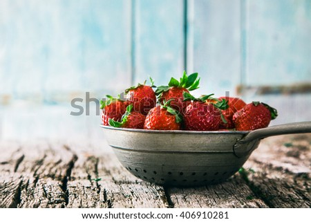 Fresh fruit. Strawberries on wood. Spring fruit. - stock photo