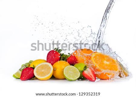Fresh fruit with water splash, isolated on white background - stock photo