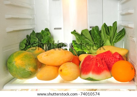 Fresh Fruits And Vegetables In A Refrigerator - stock photo