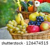 Fresh fruits and vegetables in the wicker baskets - stock photo
