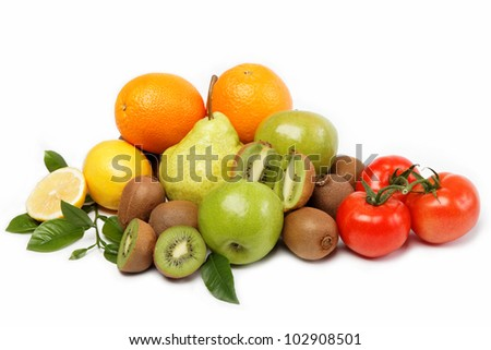 Fresh fruits and vegetables isolated on a white background. - stock photo
