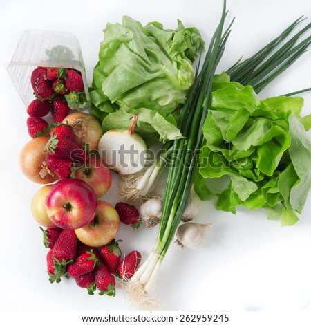 Fresh fruits and vegetables on desk with water drops on its - stock photo