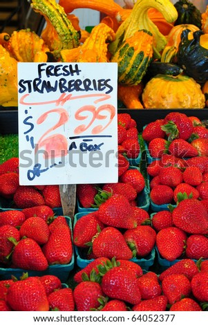 Fresh fruits and vegetables on display in a farmers market - stock photo