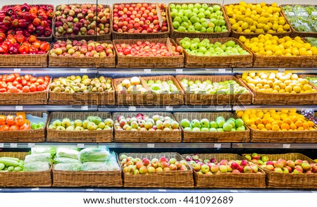 Fresh fruits and vegetables on shelf in supermarket. For healthy concept - stock photo