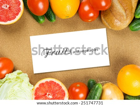 Fresh fruits and vegetables on table background. Food concept - stock photo
