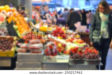Fresh fruits at the market - blurry background - stock photo