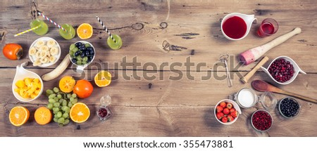 Fresh fruits, berries, smoothie and juice on vintage cocking background - detox, diet or healthy food concept, banner with copy space. Rustic style, top view - stock photo