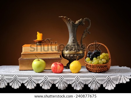 Fresh fruits, books and metal carafe - stock photo