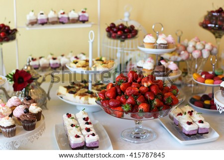 fresh fruits cakes and sweets in a candy bar - stock photo