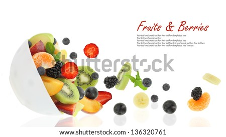 Fresh fruits coming out from a bowl - stock photo