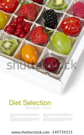 Fresh fruits in a chocolate box - humorous diet concept - stock photo