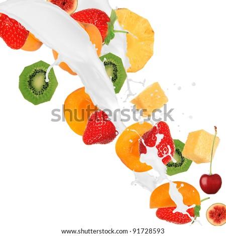 Fresh fruits in cream splash over white background - stock photo
