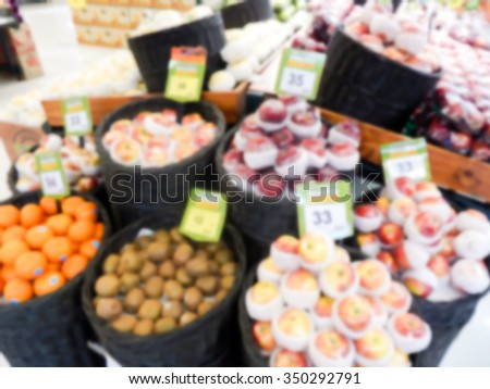 Fresh fruits in supermarket blurred background - stock photo