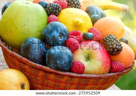 Fresh fruits in wicker basket  - stock photo