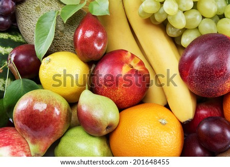 Fresh fruits isolated on a white background. Set of different fresh fruits.
