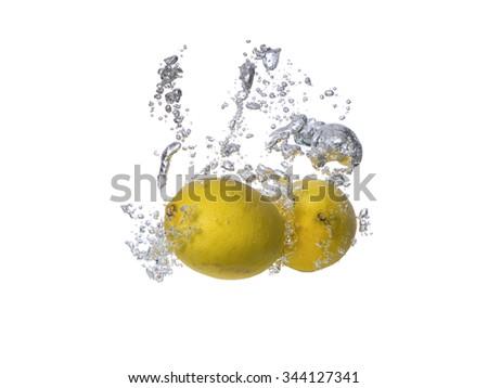 Fresh fruits, lemon falling in water splash, isolated on white  - stock photo