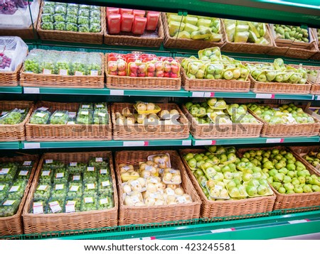 Fresh fruits on shelf in supermarket. For healthy concept - stock photo