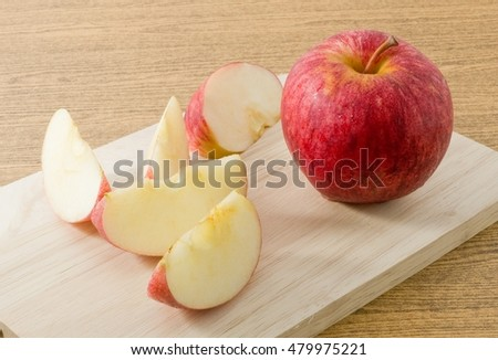 Fresh Fruits, Ripe and Sweet Red Apple on A Wooden Tray.