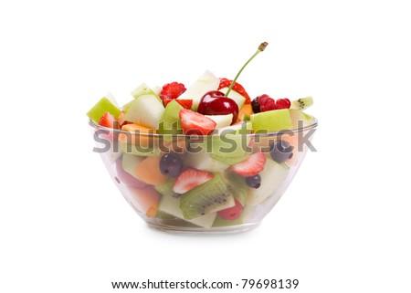 Fresh fruits salad in bowl isolated on white background - stock photo