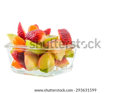 Fresh fruits salad in bowl on white background