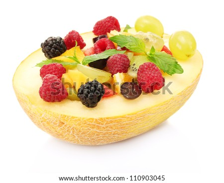 fresh fruits salad in melon, isolated on white - stock photo