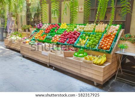 Fresh fruits shop at a market  - stock photo