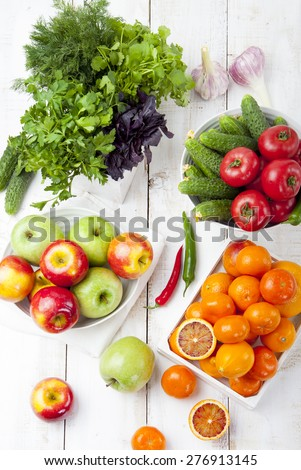 Fresh fruits, vegetables and herbs variety on a white wooden background - stock photo