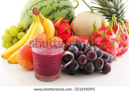 Fresh fruits with juice - stock photo