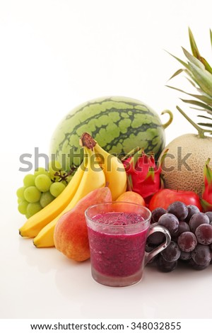 Fresh fruits with juice - stock photo