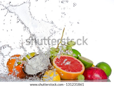 Fresh fruits with water splash isolated on white - stock photo