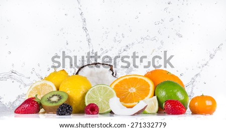 Fresh fruits with water splash on white background. - stock photo