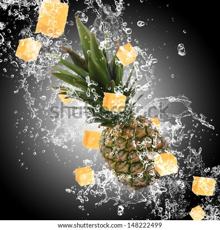 Fresh fruits with water splashes on dark background - stock photo