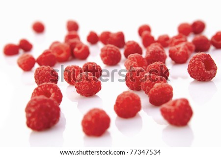 Fresh fruity raspberries isolated on white backround - stock photo