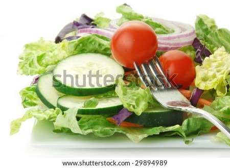 Fresh garden salad with lettuce onion tomato cucumber on white background. - stock photo