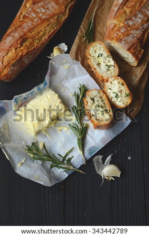 fresh garlic bread baguette made with butter and rosemary - stock photo