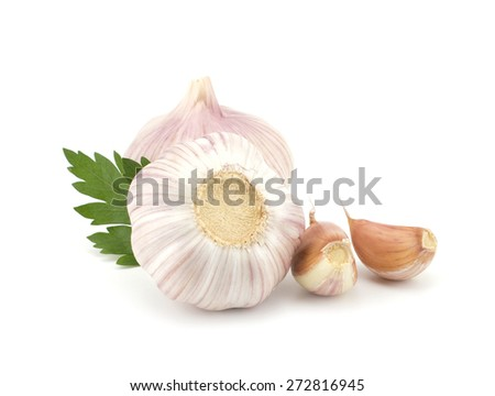 Fresh garlic bulbs with segments and parsley leaves isolated on white background - stock photo