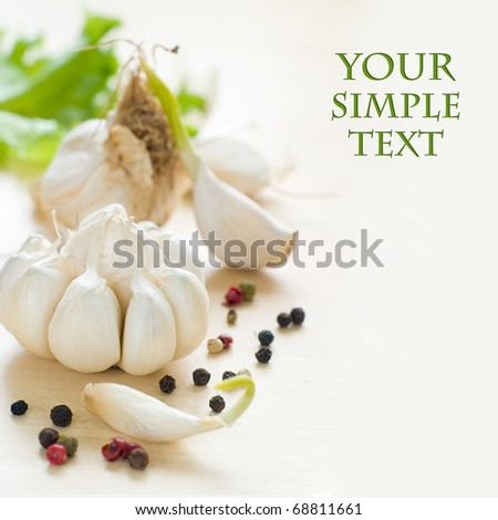 Fresh garlic on kitchen table - stock photo