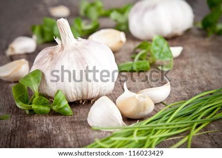 Fresh garlic on wooden table - stock photo