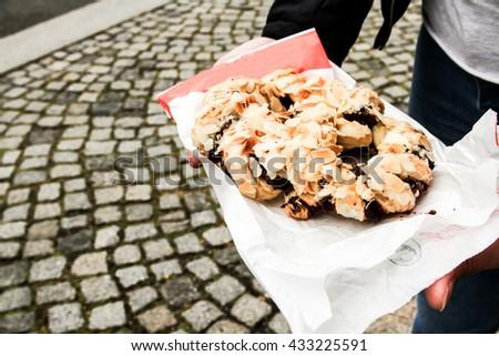 Fresh German pretzels with sea salt close-up on dark black board background - stock photo