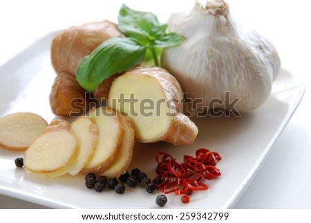 fresh ginger, spices, basil leaves and garlic for cooking in white background