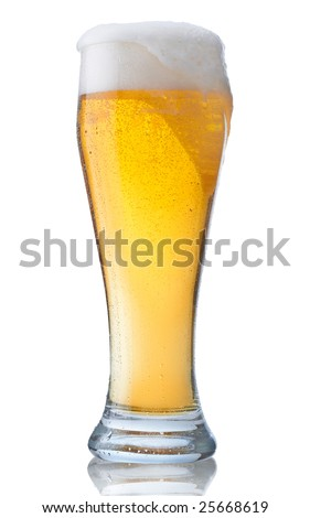 Fresh glass of beer with froth and condensed water pearls isolated on white background